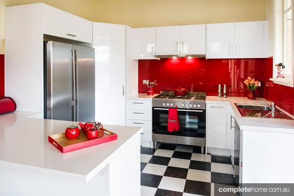 A retro kitchen with bright red splashback