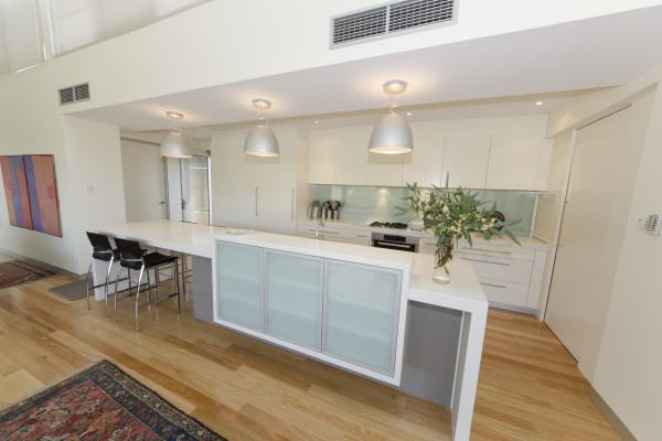 A minimalist kitchen design featuring an island counter - designed by Goolwa Kitchen