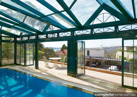 An outdoor pool and enclosure by Sunwise Pools