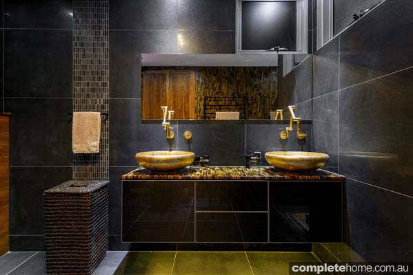 this black and gold luxury bathroom design from enigma interiors is