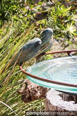Garden decor - bird sculptures on a bird bath
