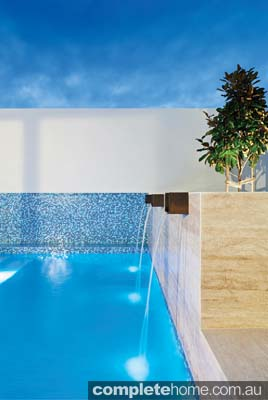 Water features on a pool by Liquid Blue Pool & Spa Design