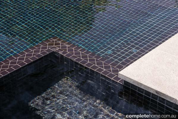 Outdoor pool - sleek dark design