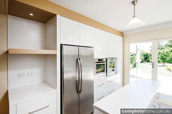 Streamlined white kitchen - stainless steal fridge