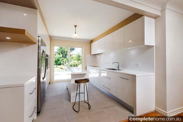 A streamlined modern white kitchen design