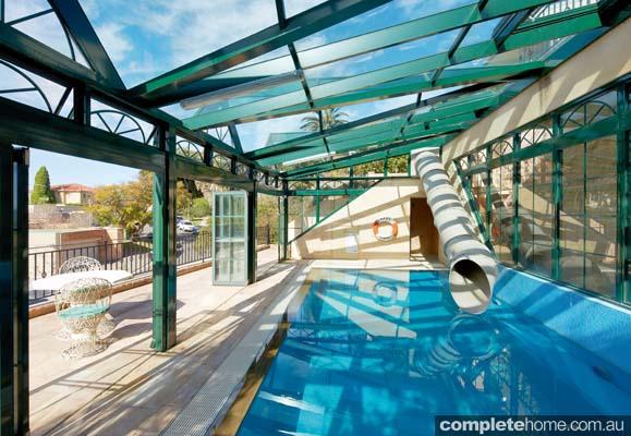 An outdoor pool enclosure with open doors