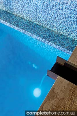 Close up of water feature on simple outdoor pool
