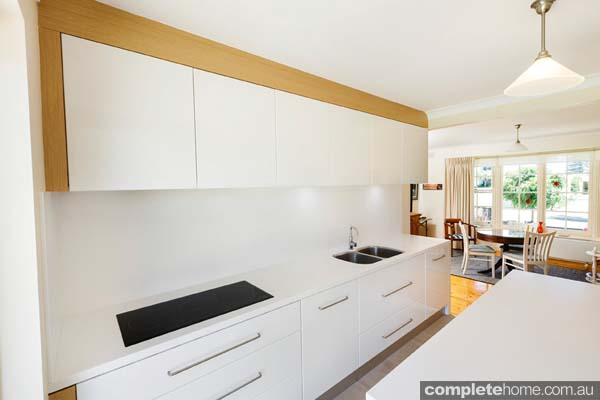 Modern white kitchen - cook top and sink
