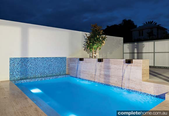 A light colour pallet on an outdoor pool by Liquid Blue Pool & Spa Design