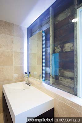 A wall made from frameless glass in a modern bathroom - Euroglass