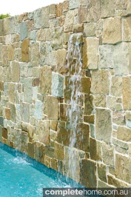 Sandstone wall in pool design, by Neptune Pools