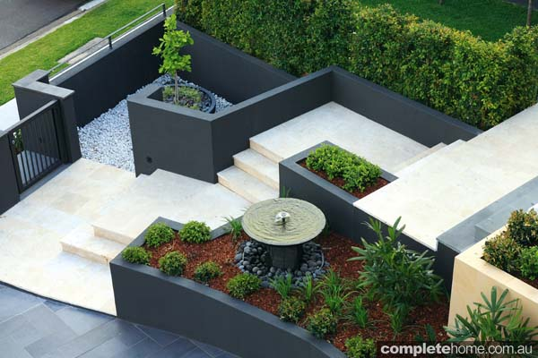 Perfect harmony of formal and tropical in a designer for Garden design elements