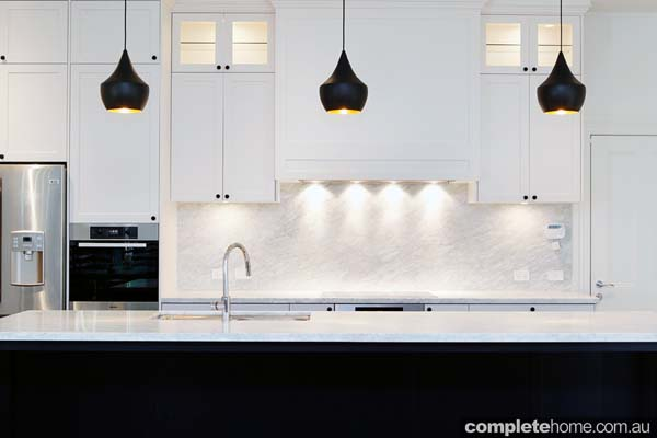 A black and white contemporary kitchen design from The Kitchen Place.