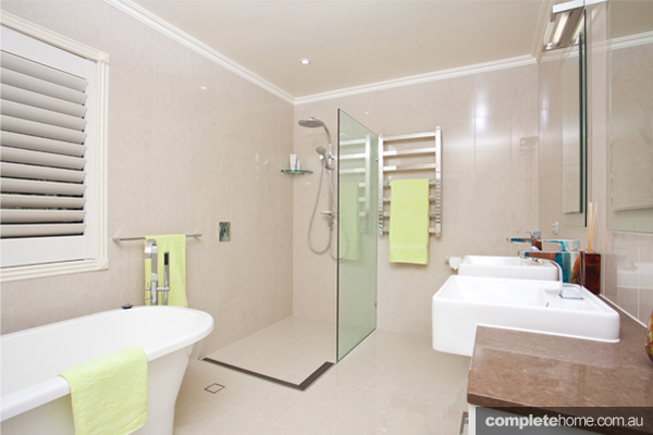 An inviting and contemporary bathroom design completehome for L shaped bathroom layout