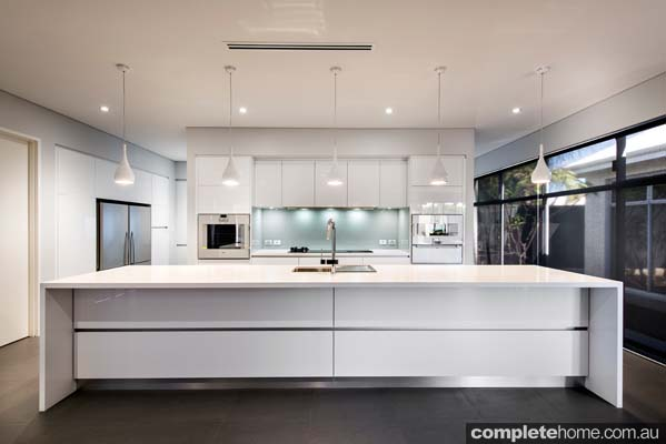 A contemporary white kitchen design from Western Cabinets.