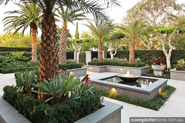 Formal design meets tropical landscape completehome for Tropical garden designs