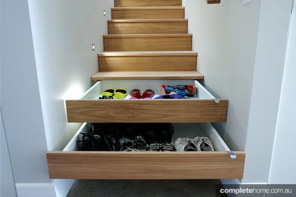 A handy storage space hidden under the stairs.