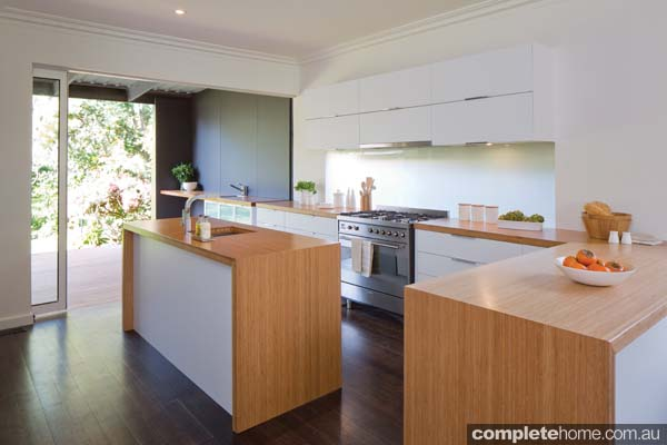 A modern, multi-functional kitchen space created with Kaboodle Kitchen products