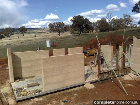 The construction of a rammed earth house.
