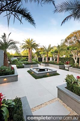 Formal and tropical merge in this landscape design from Franklin Landscapes & Design.