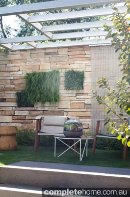 An outdoor room with grass walls.