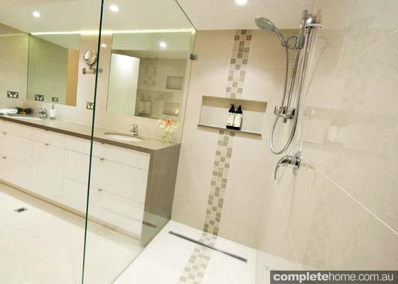 A frameless glass shower featured in this luxurious bathroom.
