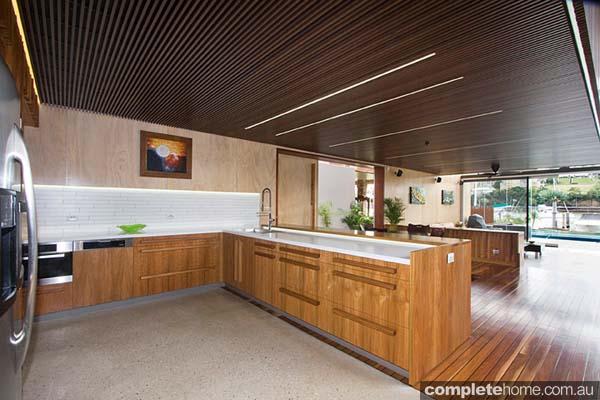 An open plan timber kitchen design.
