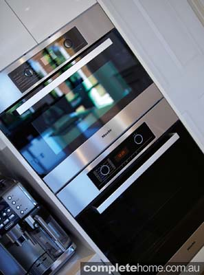 A sleek black oven in a contemporary kitchen design from Brilliant SA.