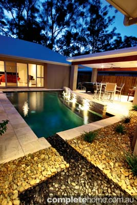 An award-winning pool featuring a loose pebble ledge from Majestic Pools & Landscapes.