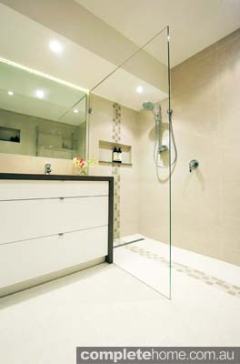 This luxury bathroom features a frameless glass shower.
