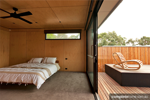 The bedroom in the modern timber tree house.