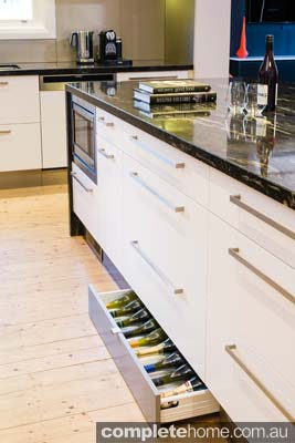 Seamless storage integration in this modern kitchen.