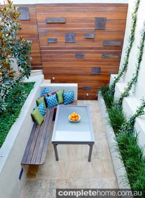 A small outdoor room from Outhouse Design.