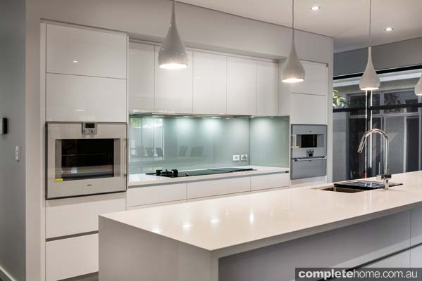 Real kitchen an understated contemporary space completehome for White contemporary kitchen designs