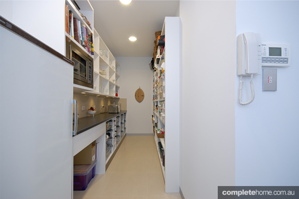 A walk-in pantry in an innovative kitchen from Goolwa Kitchens and Wardrobes.