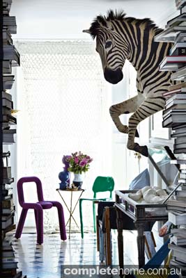 Crazy zebra art from Christian Lacroix featured in this Paris apartment.