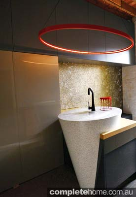 A dynamic conical sink and bar featured in a unique kitchen.