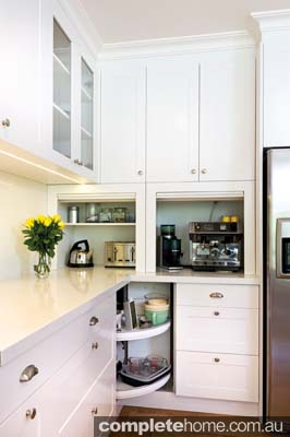 Effective storage in this fresh kitchen from Kitchens by Peter Gill.
