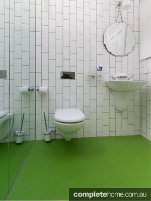 A Bathroom With Green Rubber Flooring