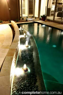 An impressive water feature and pool design from Majestic Pools & Landscapes.