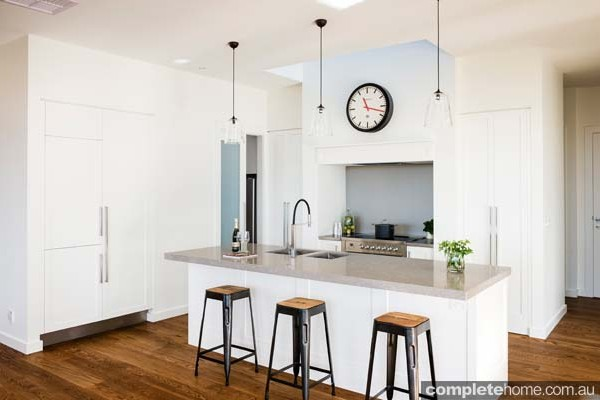 A light minimalist kitchen design with american oak flooring.