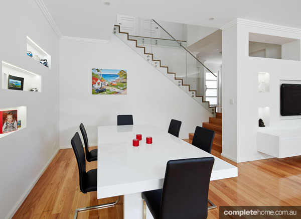 The dining room and staircase in a duplex from M.A.G Constructions.