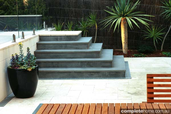 Formal meets tropical in this landscape design from Cool Water Landscapes.