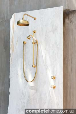 An outdoor brass shower from The English Tapware Company.