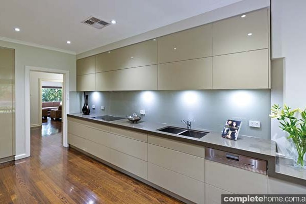 A sleek and streamlined designer kitchen from Kitchens by Peter Gill.