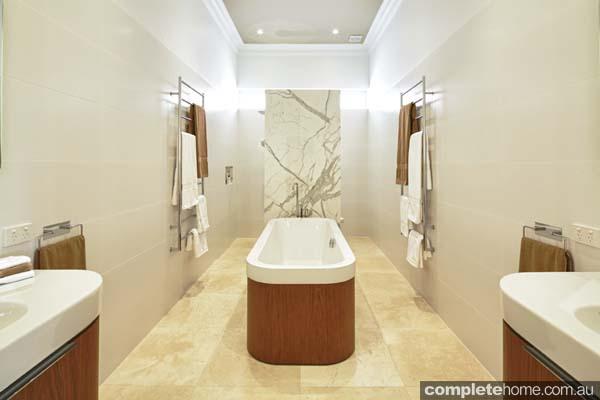 A bathroom design with a hidden toilet.