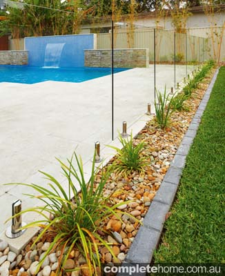 Beautiful glass fencing surrounding a swimming pool.