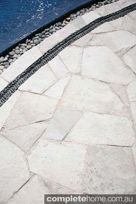 A light stone paving that is protected with STAIN-PROOF™ sealer.