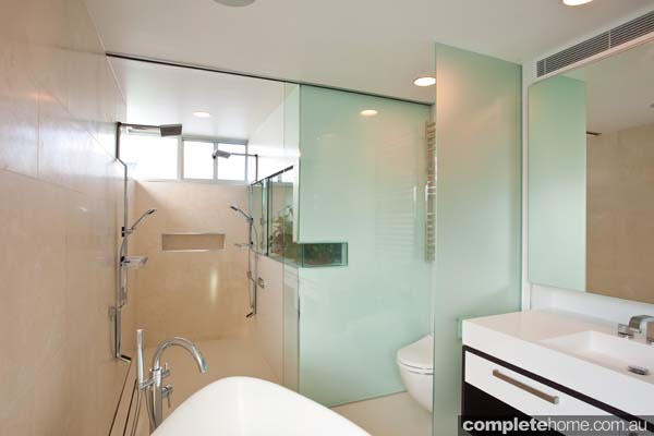 A modern bathroom featuring a frameless shower screen from Euroglass.