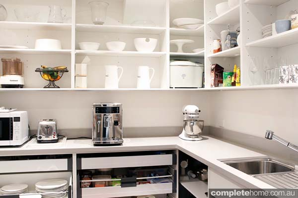A white contemporary butler's pantry.